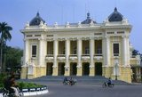 The Hanoi Opera House is modelled on the Paris Opera designed by Charles Garnier and completed in 1875. It is known in Vietnamese as Nha Hat Lon or 'Big Song House' and opened in 1911 incorporating the same grand elements of Garnier's Napoleonic design. It remains the centrepiece of French architecture not just in Hanoi, but in all of former French Indochina and its presence would grace any city in the world.<br/><br/>   Before the Second World War, the Opera was at the centre of French cultural life in Hanoi. After independence, however, it gradually fell into disrepair. Occasionally Chinese or Russian artistes would appear – perhaps a performance of the militant ballet beloved of Madame Mao, 'The Red Detachment of Women', or a musical recital by a visiting fraternal ensemble from Moscow or Minsk – but by the mid-1980s even these limited cultural exchanges had ceased, and the once grand Hanoi Opera was all but abandoned.<br/><br/>    In 1994, the authorities decided to restore and reopen the Opera in a three-year project costing US$14 million. Today the grandly colonnaded colonial edifice, repainted in mustard yellow and white, and filled with refurbished gilt mirrors and ornate grand stairways, must be every bit as magnificent as on the day it opened in 1911.<br/><br/>  As the Hanoi Opera has grown in confidence and popularity, so it has staged some quite unusual and innovative programmes – for example a version of Christoph Gluck's two-century old opera Orfeo et Euridice in Vietnamese.